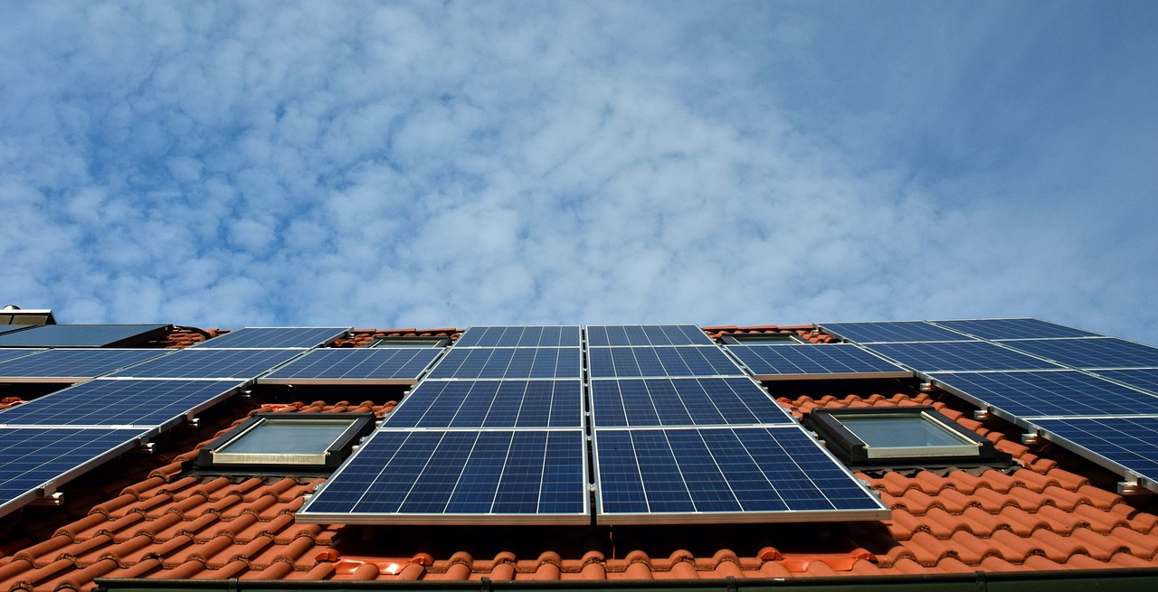 Multiple solar panels installed on the top of a tile roof