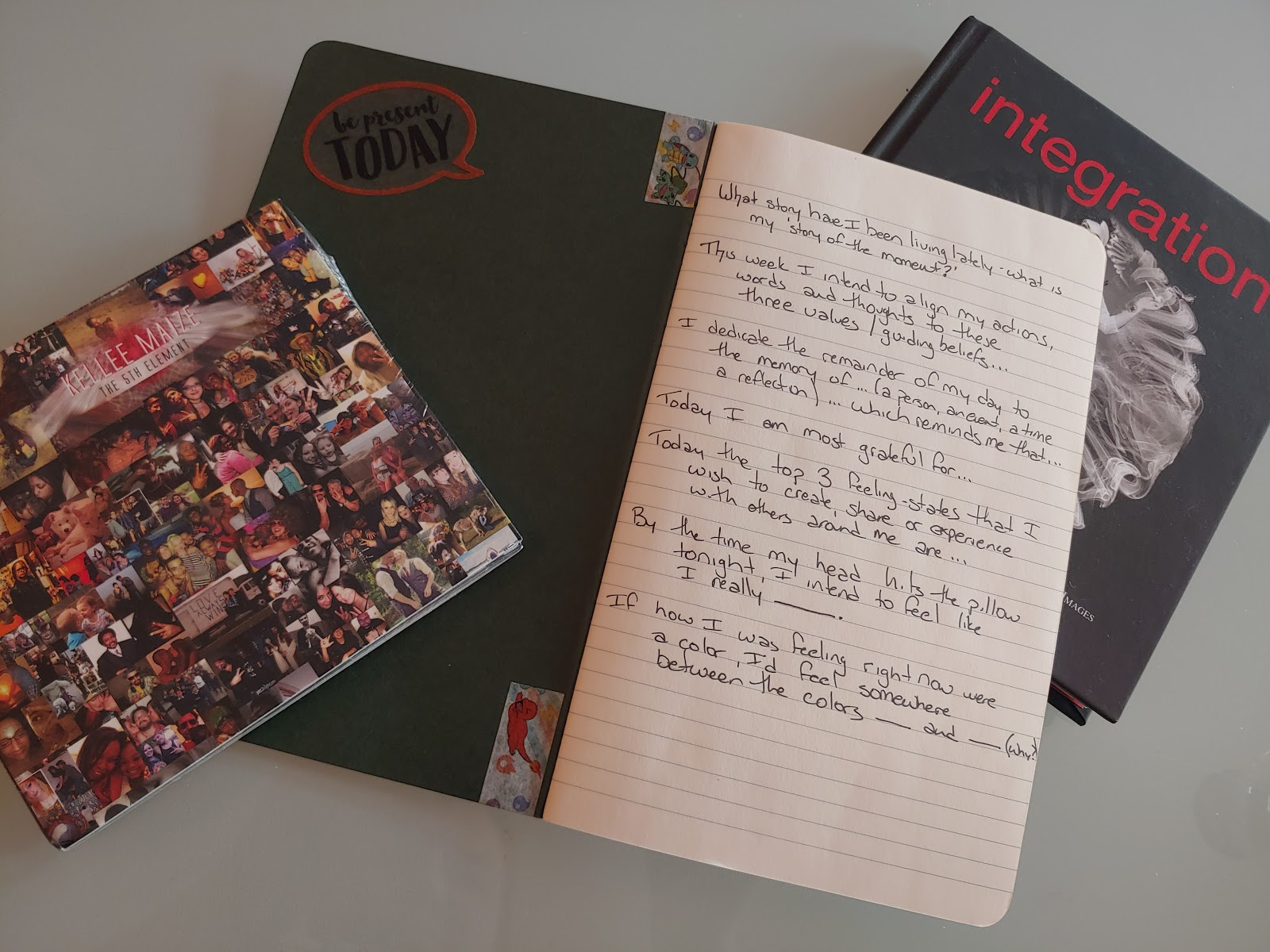 Open Journal with CD and Book showing prompts for journaling written on front page