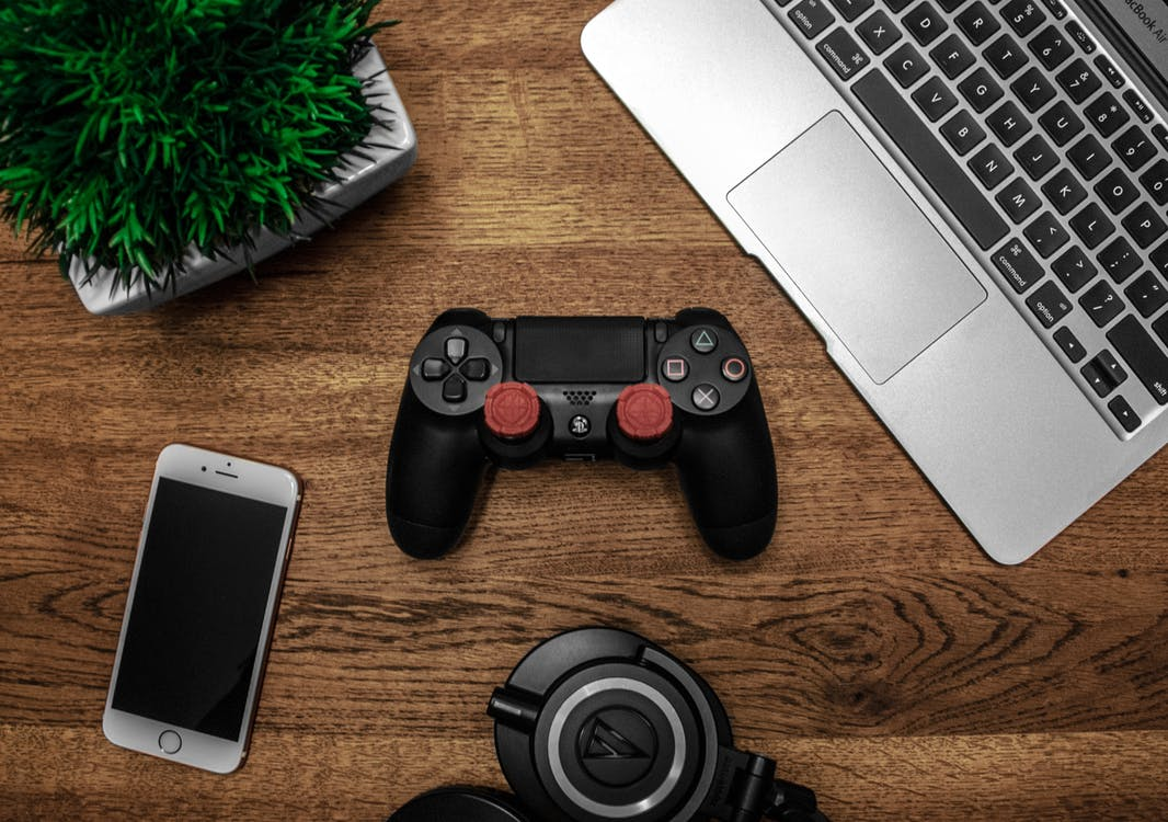 Laptop, Controller, Phone, Plant, and Headphones