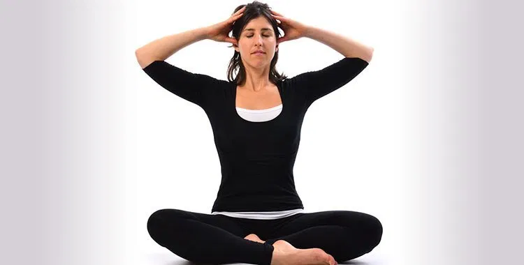 Woman doing Bhramari meditation