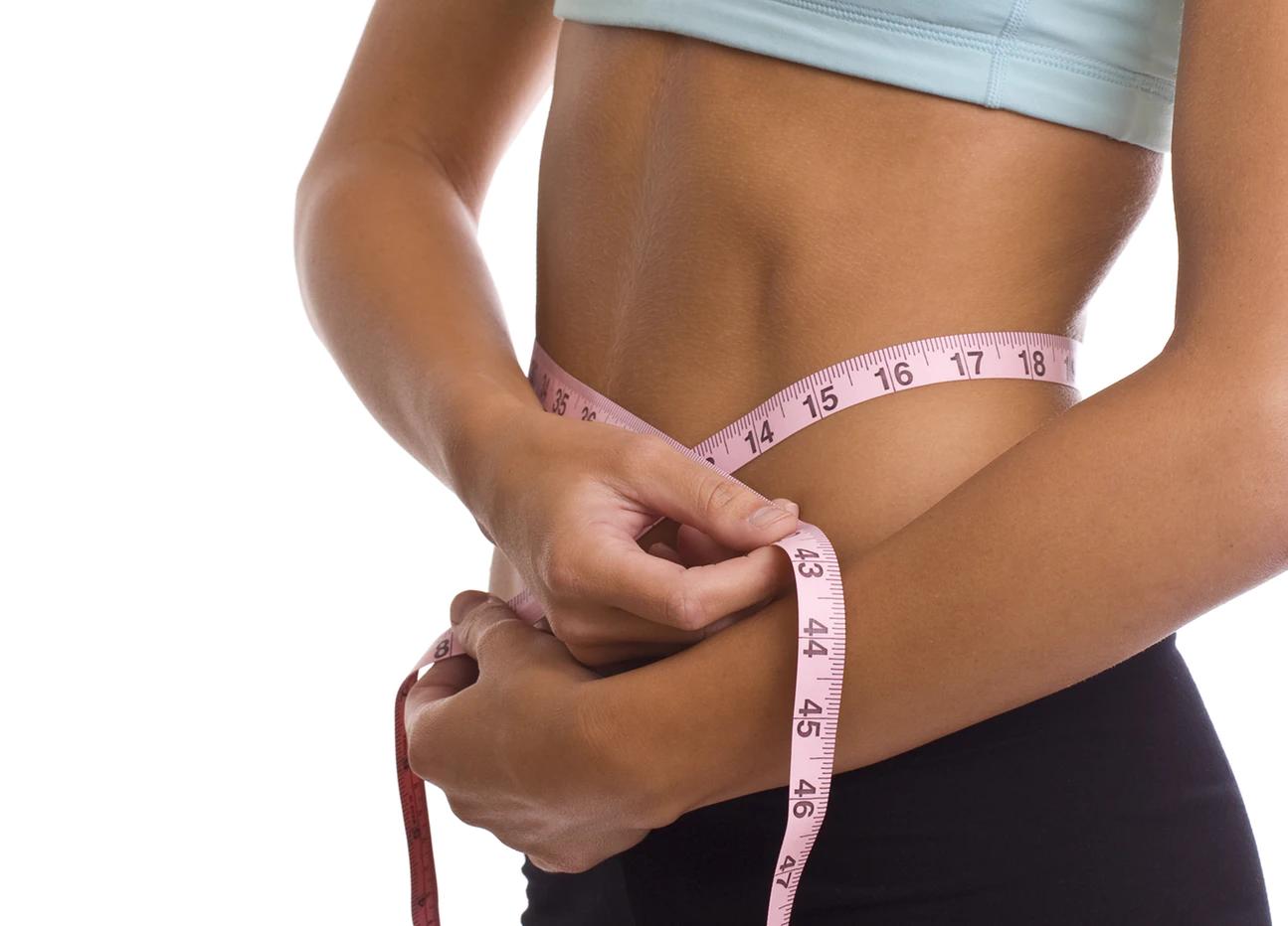 Tape measuring around waist