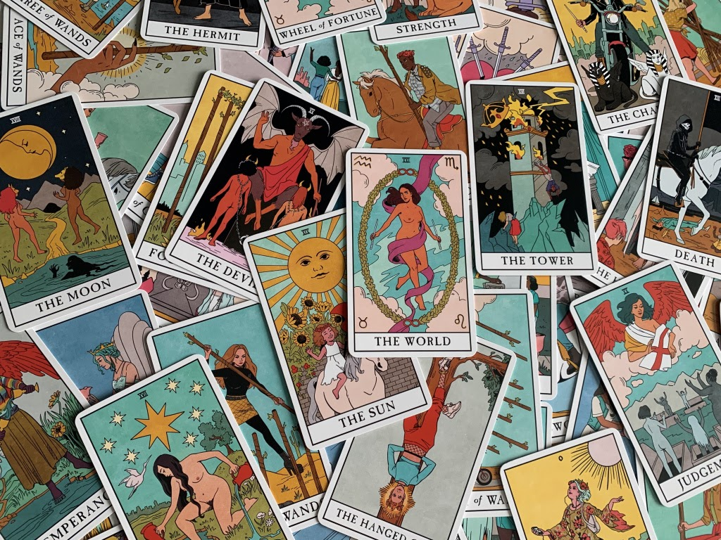 The Modern Witch Tarot deck displayed on a table.