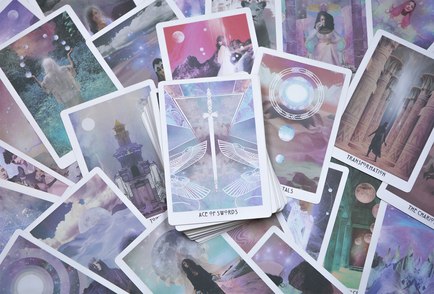 The Starchild Tarot Deck displayed on a table.