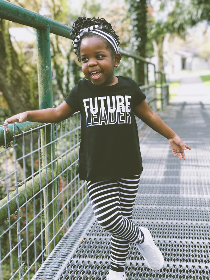 """Young black girl wearing a shirt that says """"FUTURE LEADER"""""""