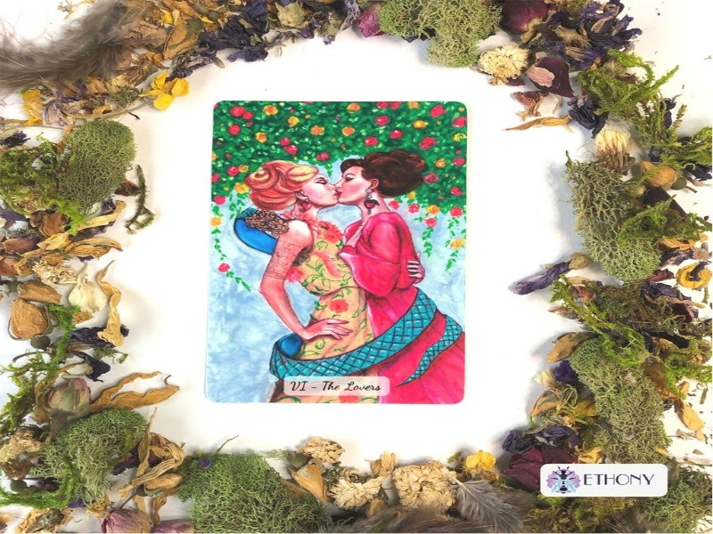 A picture of the lovers card depicting two women kissing