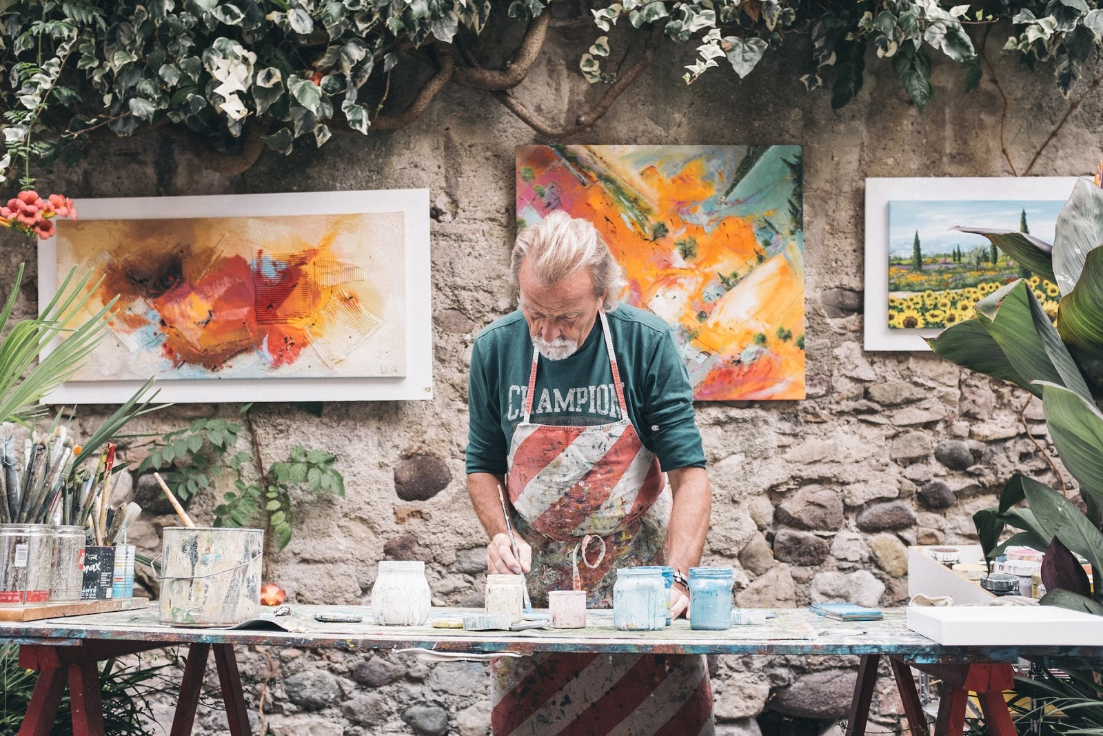 a painter works in an outdoor studio
