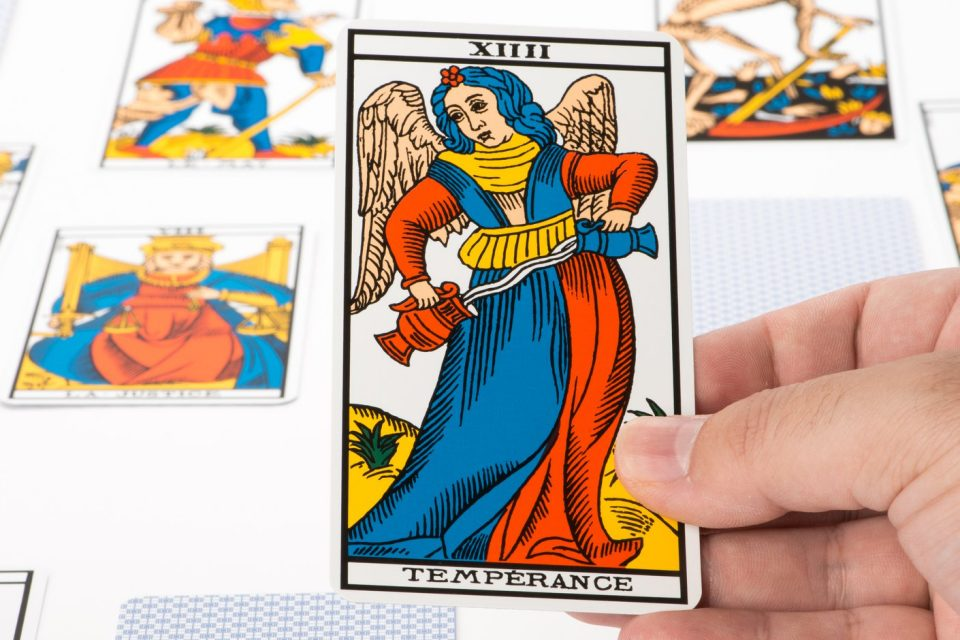 a red and blue temperance tarot card