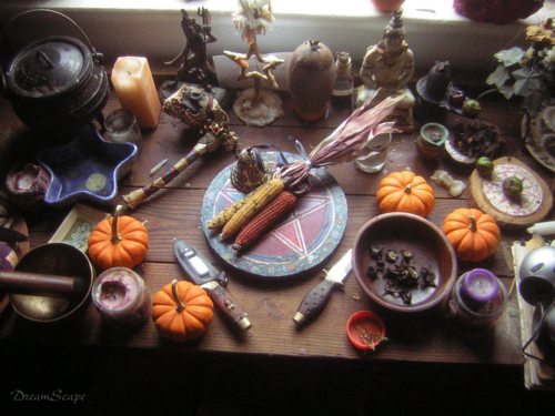 Samhain altar with harvest foods, pentagrams, and candles