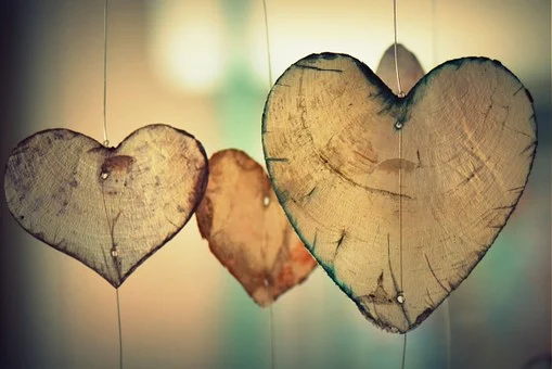 Wooden hearts are hanging.