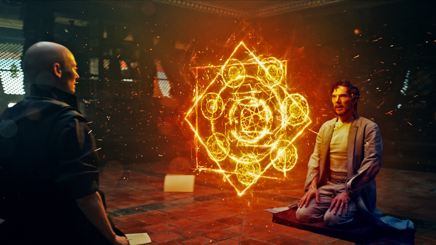 Scene from Doctor Strange where a woman and a man are sitting facing each other with an orange object between them