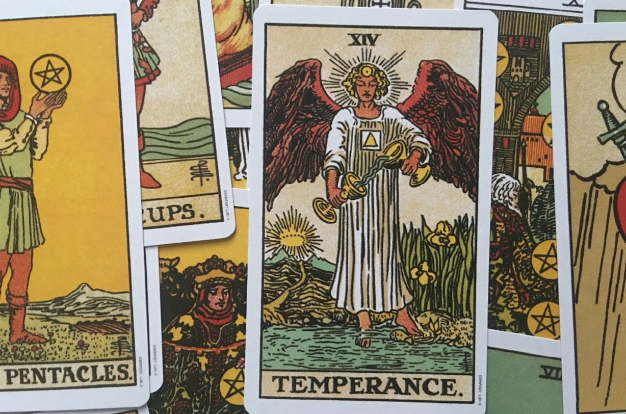 the temperance tarot card in a pile of many tarot cards