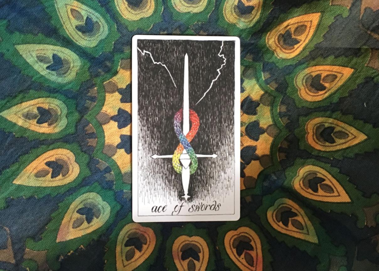 ace of swords tarot card on an altar