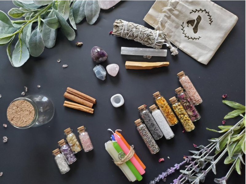 A beginner's witch kit with crystals, candles, and essence