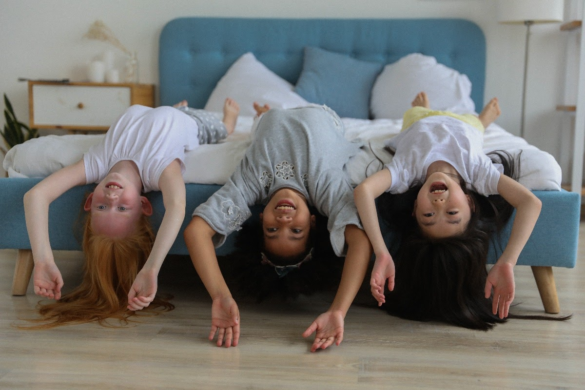 3 girls playing and laying upside down