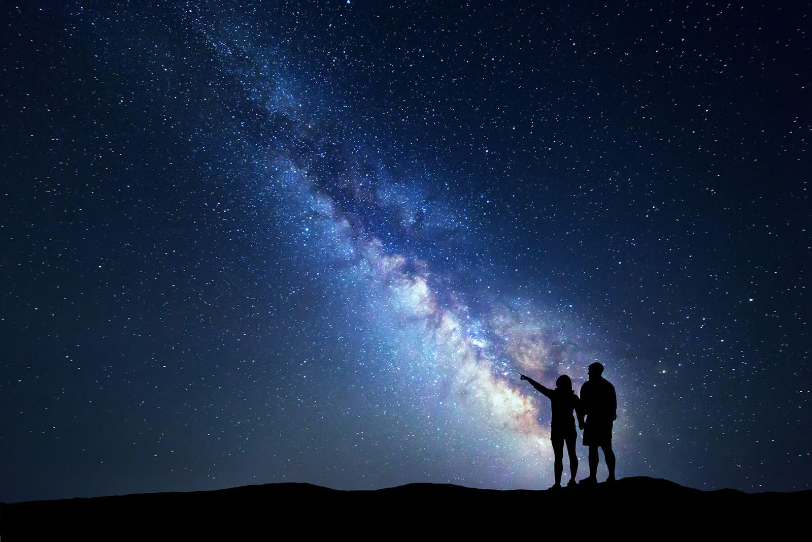Two people stargazing.