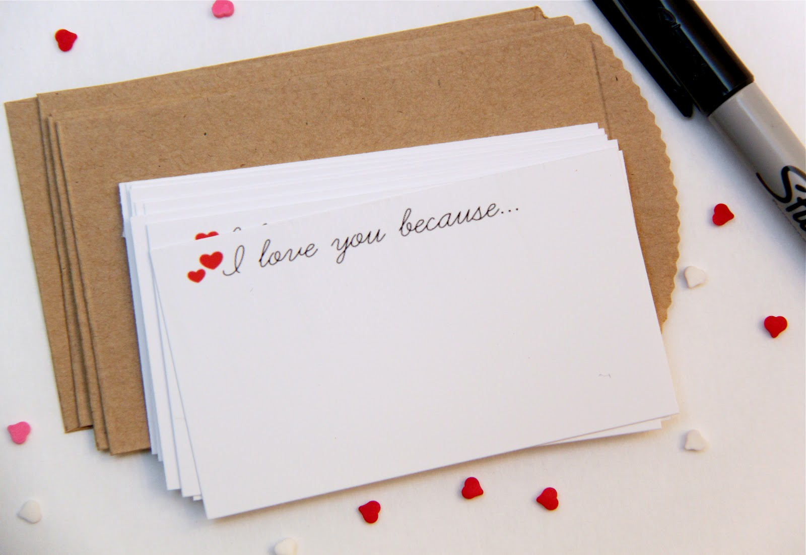 "A stack of white cards that say ""I love you because...""'"