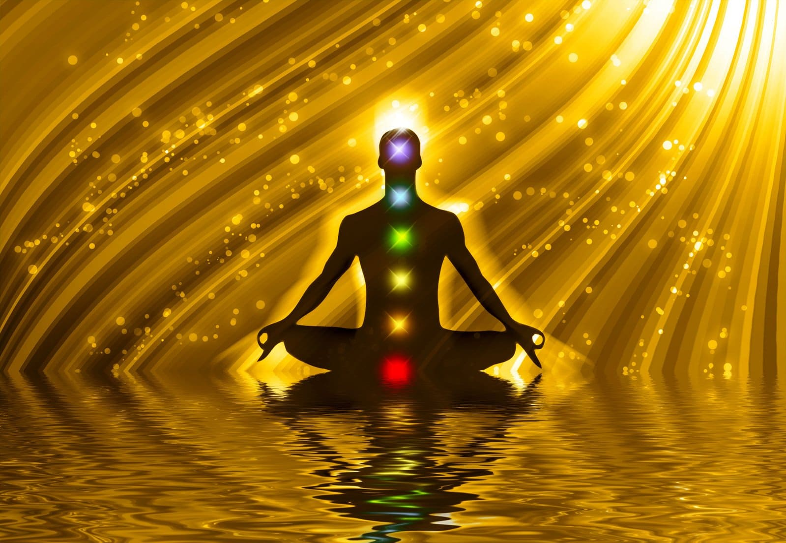 A gold background with a silhouette of a man seated in a meditation posture with glowing balls of colored chakras lined up through his spine