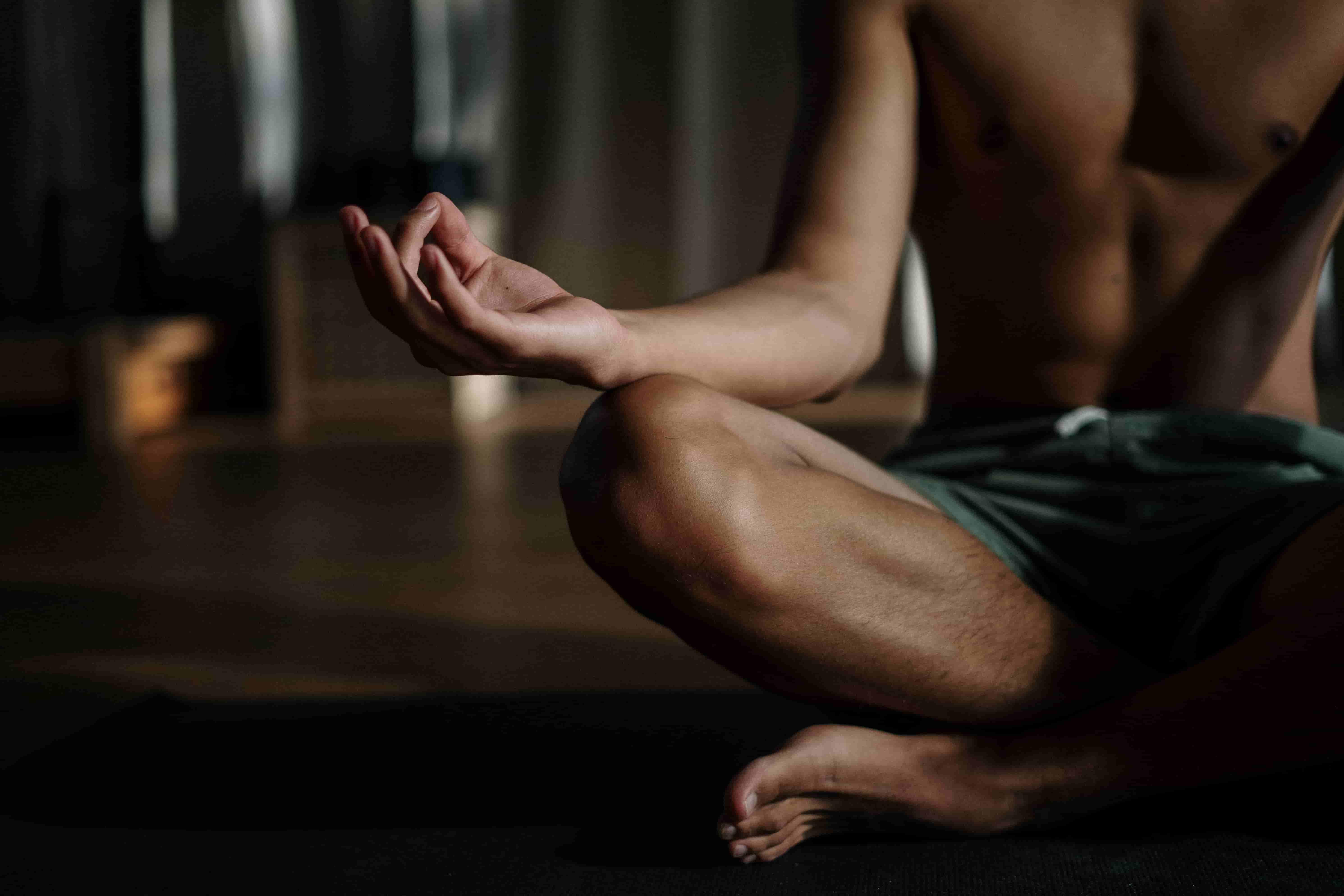 A man in a meditative posture