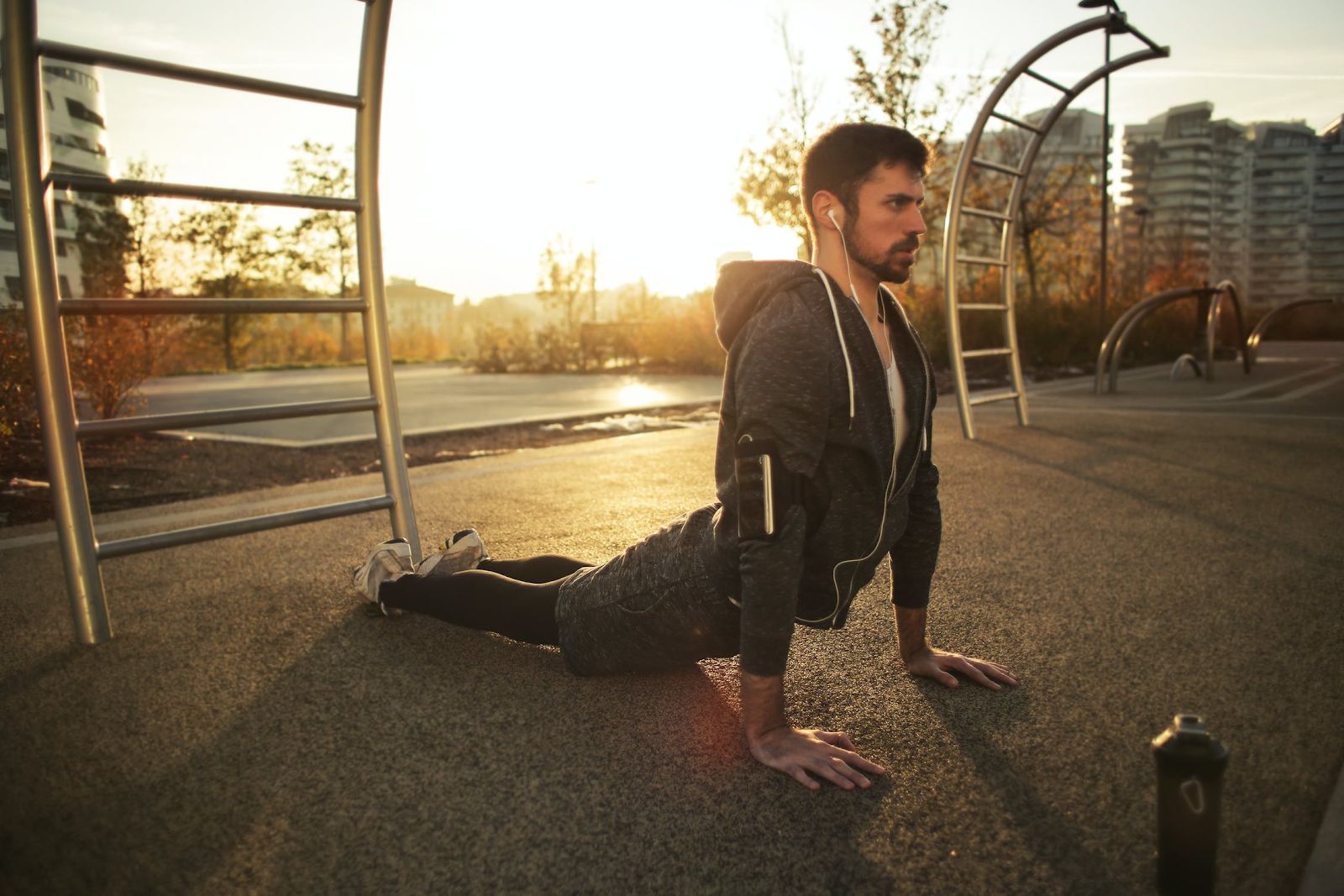 Man performing quadruped yoga poses in an effort to incorporate them into his daily workout.