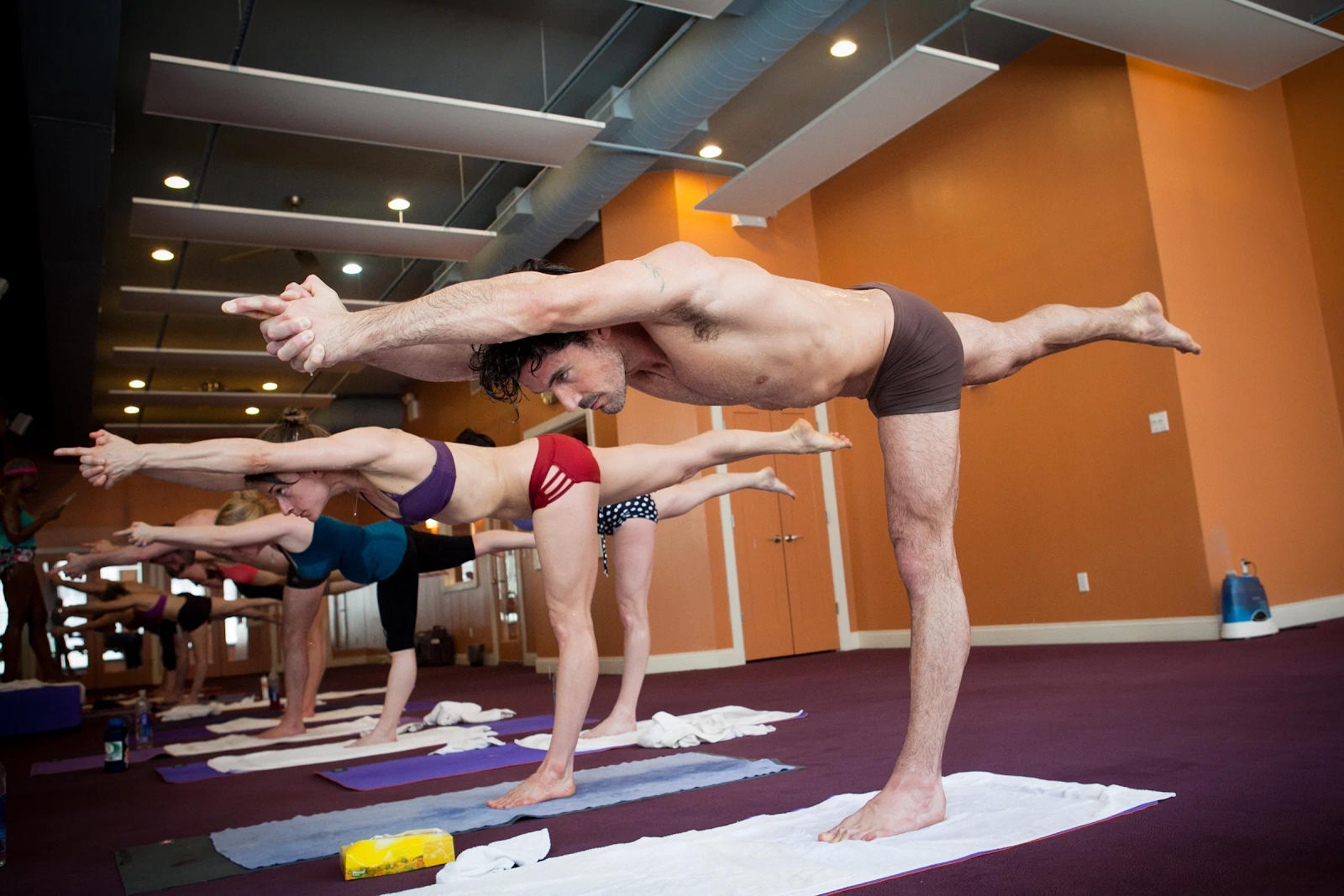 A group class practicing Bikram yoga.