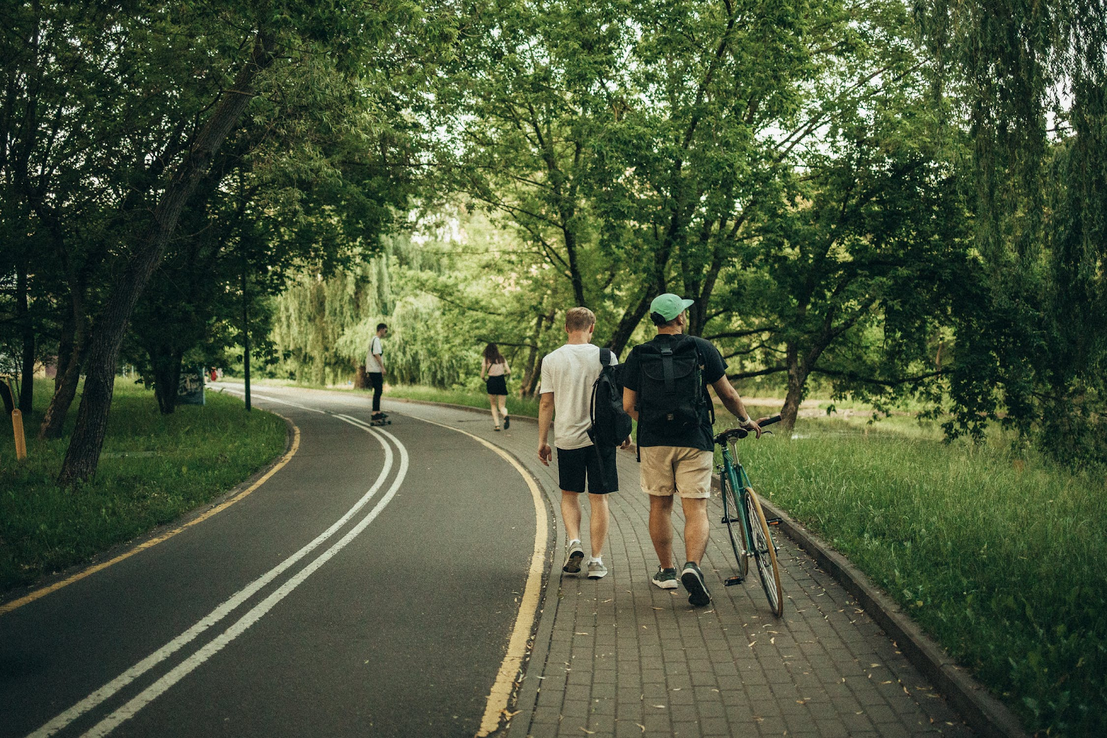 People walk and bike as a form of transportation for their travels.