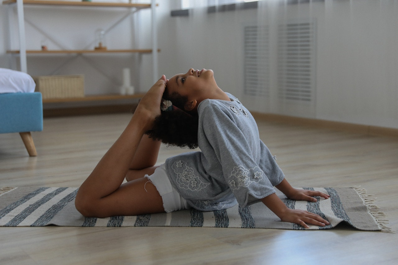 a young girl in a yoga pose