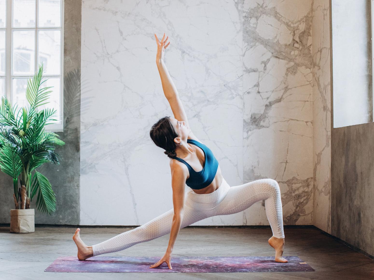 A woman practices anusara yoga.