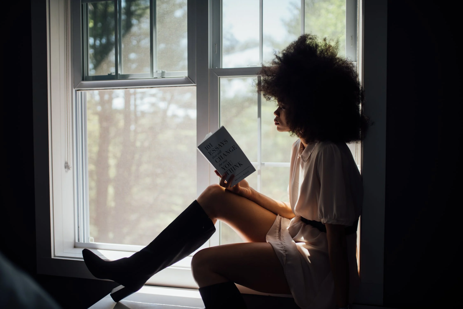 Woman reading by a window.