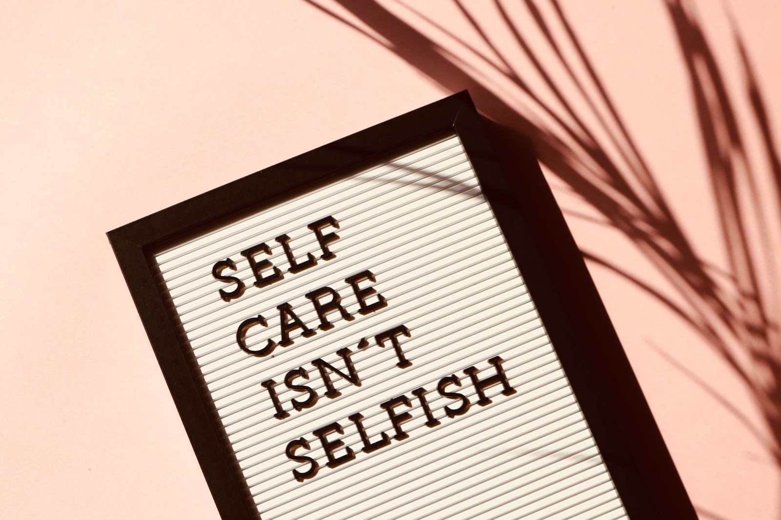 """Sign that reads, """"Self care isn't selfish."""""""