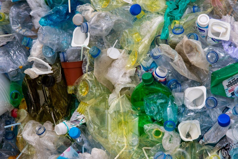 variously colored plastic bottles and bags fill an area.