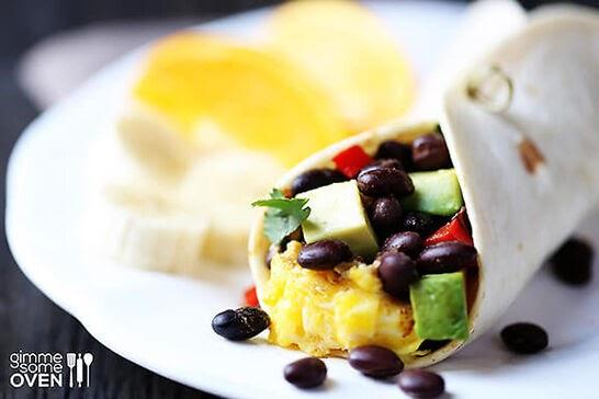 A black bean, egg, and avocado filled burrito.