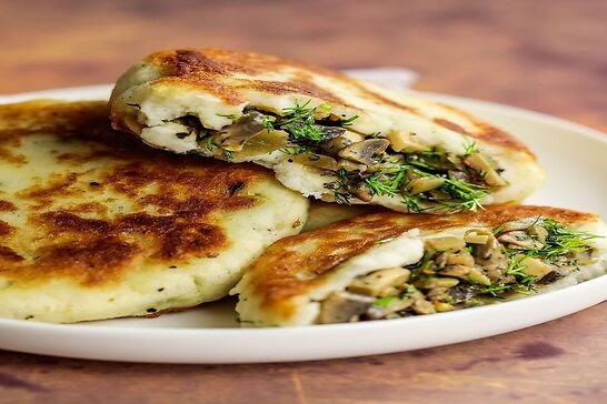 Potato pancakes filled with dill and mushrooms.