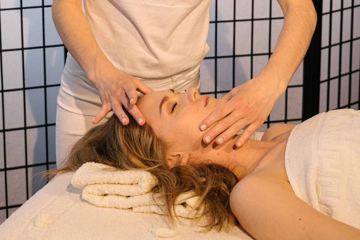 A woman getting a face massage.