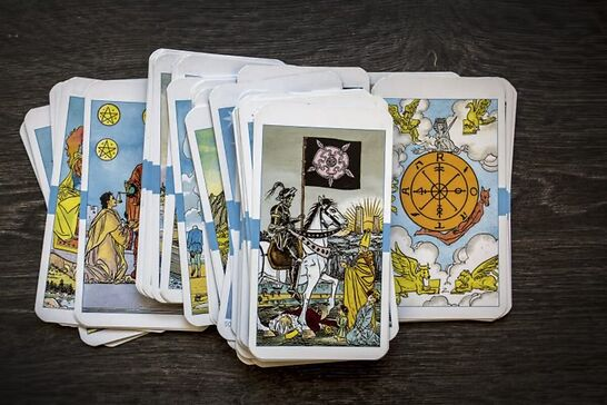 Tarot cards laid out on a table.