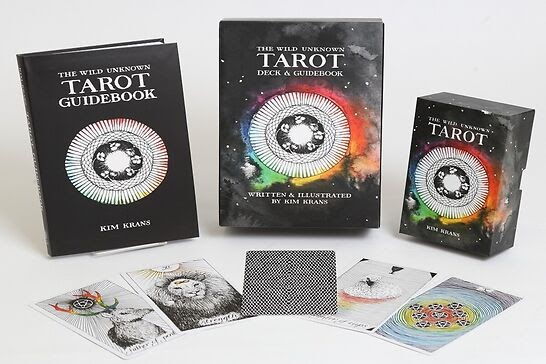 Black tarot deck with rainbow ring with guidebook.