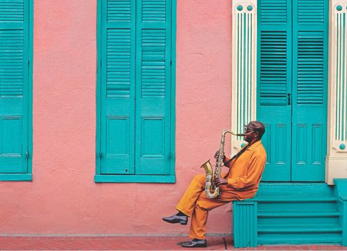 Street performer shown playing the saxophone on a street corner. Live music and entertainment fill the streets of Havana day and night. Image courtesy of weheartit.com.