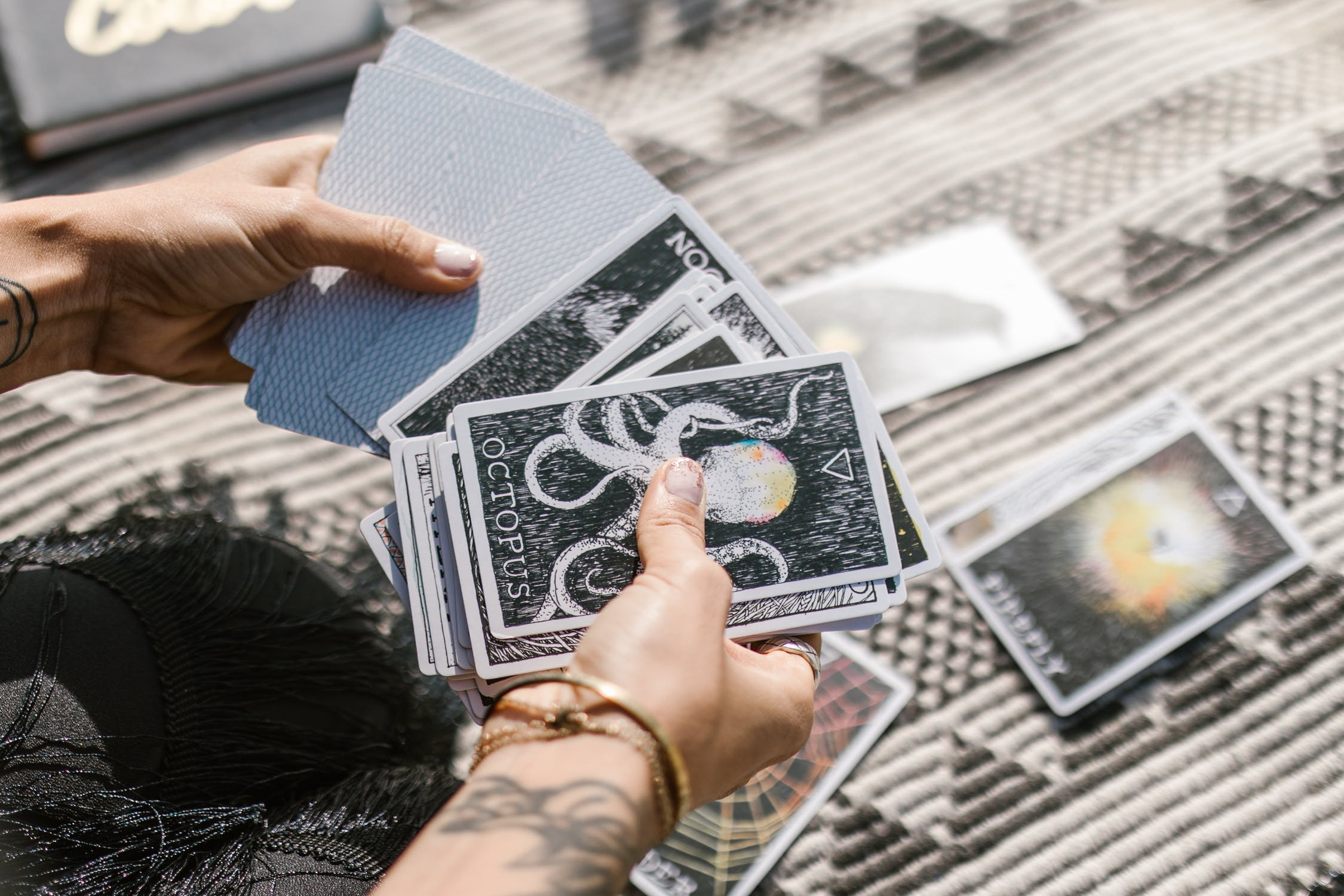 Person holding tarot cards
