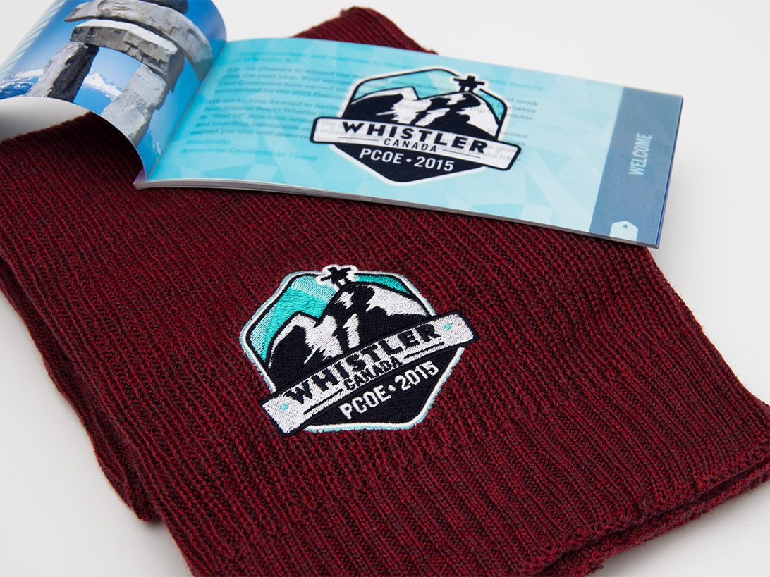 Whistler Canada PCOE 2015 logo embroidered on a red scarf with an event guide