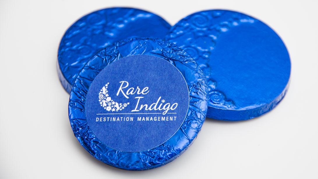 Custom moulded chocolates from Rare Indigo moon logo elements with a Rare Indigo sticker