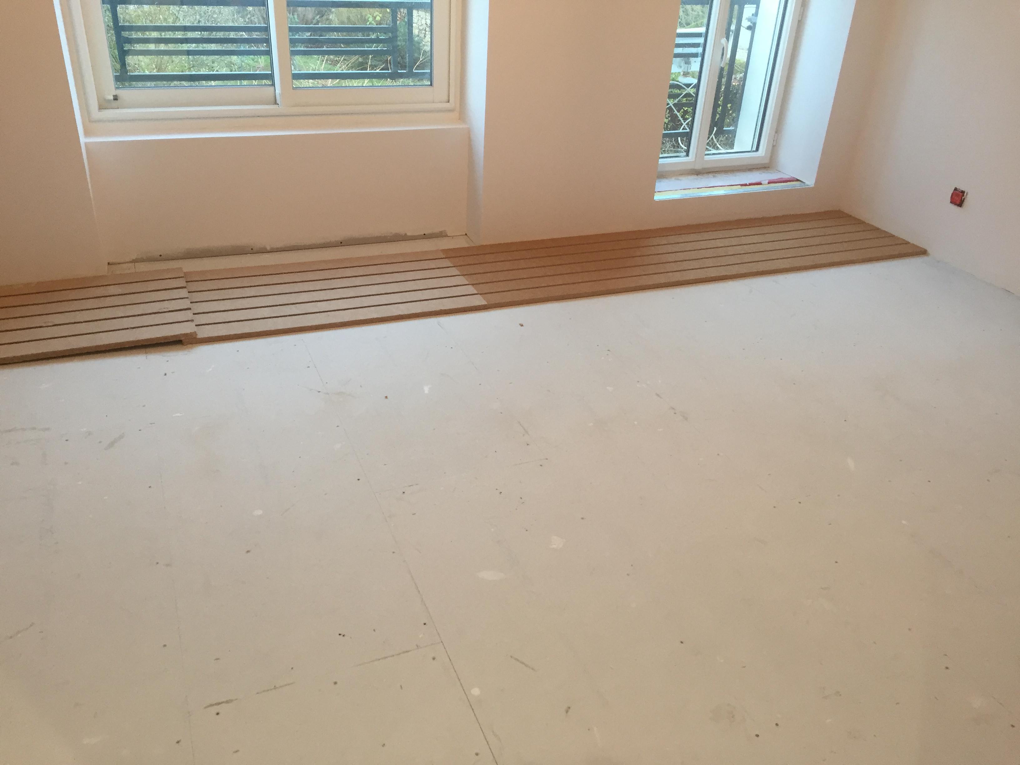 Mise en place de sur-plancher chauffant en aménagement de combles