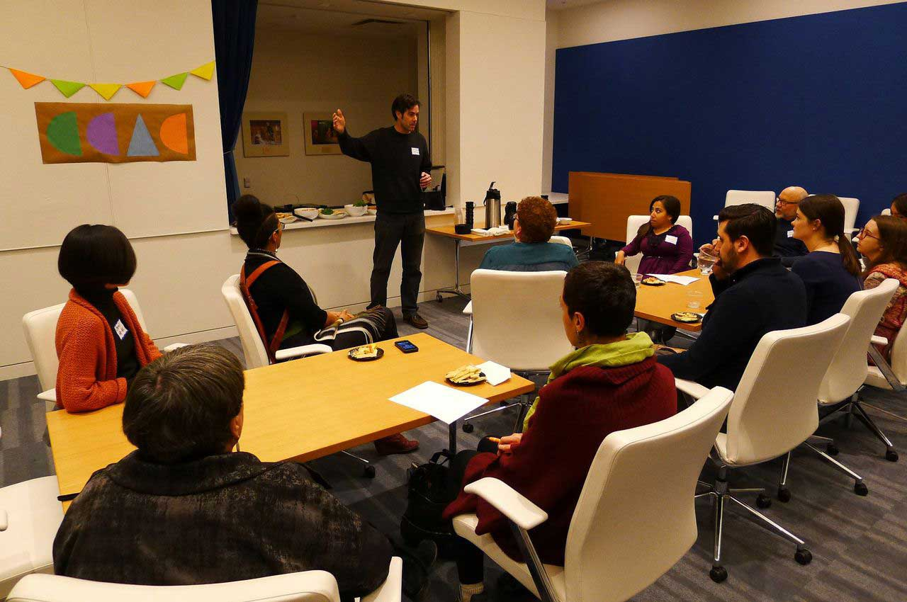 Photo of Evan Hatfield giving a presentation to a group.
