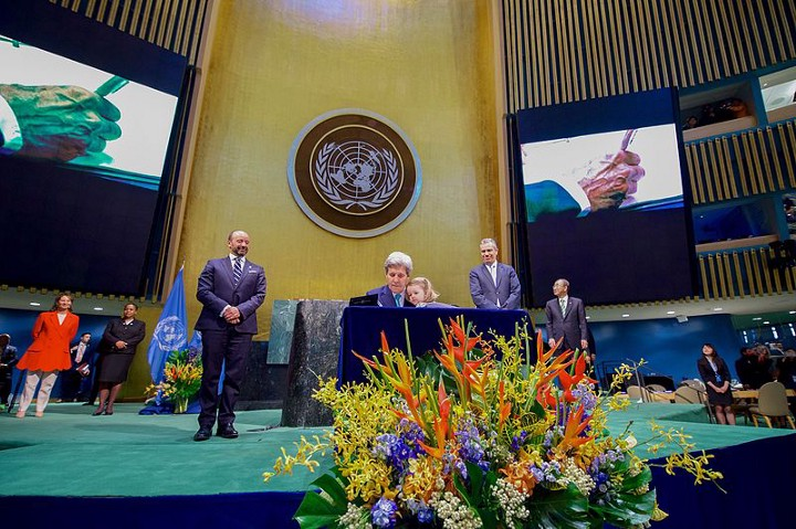 U.S. Secretary of State John Kerry signs the Paris Climate Change Agreement at the UN on Earth Day, 2016. The U.S. is bound by international law to abide by the agreement. Under its conditions, it would take President Trump four years to legally withdraw. Trump says he will make a decision by the end of May, with  administration meetings scheduled this Tuesday to discuss Paris. Photo courtesy of US State Department.high level