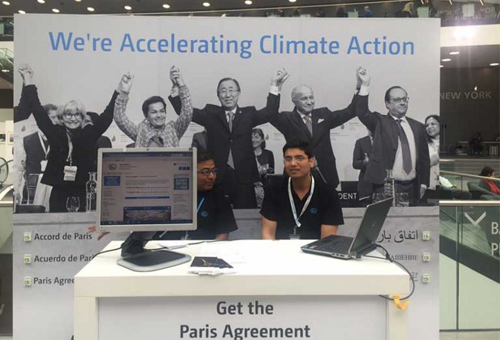 At the 2016 mid-year UN climate conference in Bonn, participants were greeted by a triumphant photo taken after the signing of the historic Paris Agreement in December 2015. The United States is currently the only country considering backing out of the agreement. Photo by Justin Catanoso.