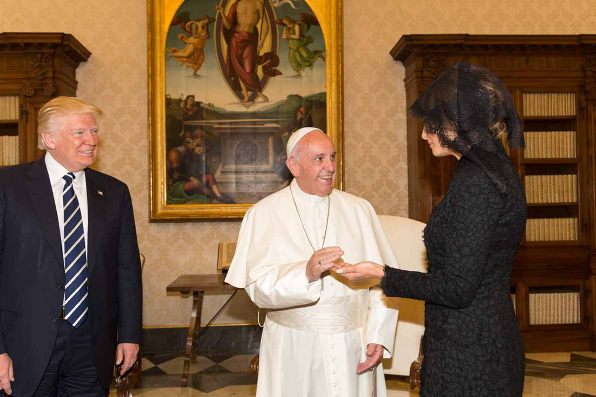 "Pope Francis greets First Lady Melania Trump with a smile. The pope and the U.S. president are worlds apart on climate change, with the pontiff seeing it as a looming threat to civilization and especially to the world's poor, while Trump has called global warming ""a hoax"" and pulled out of the Paris Agreement. White House photo licensed under the Creative Commons Attribution 3.0 United States license."