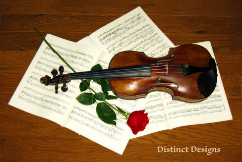Distinct Designs picture of violin and rose with music underneath