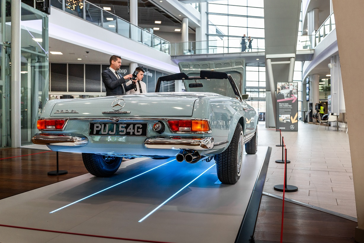 Fans taking photos of Hemmels W113 280SL Pagoda in Horizon Blue at  Mercedes-Benz World, UK