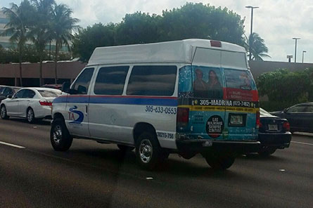 Del Toro Insurance back wrap on a Transportation America shuttle