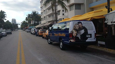 Simon Malls Shuttle Back Wrap on a SuperShuttle van seen at Ocean Drive