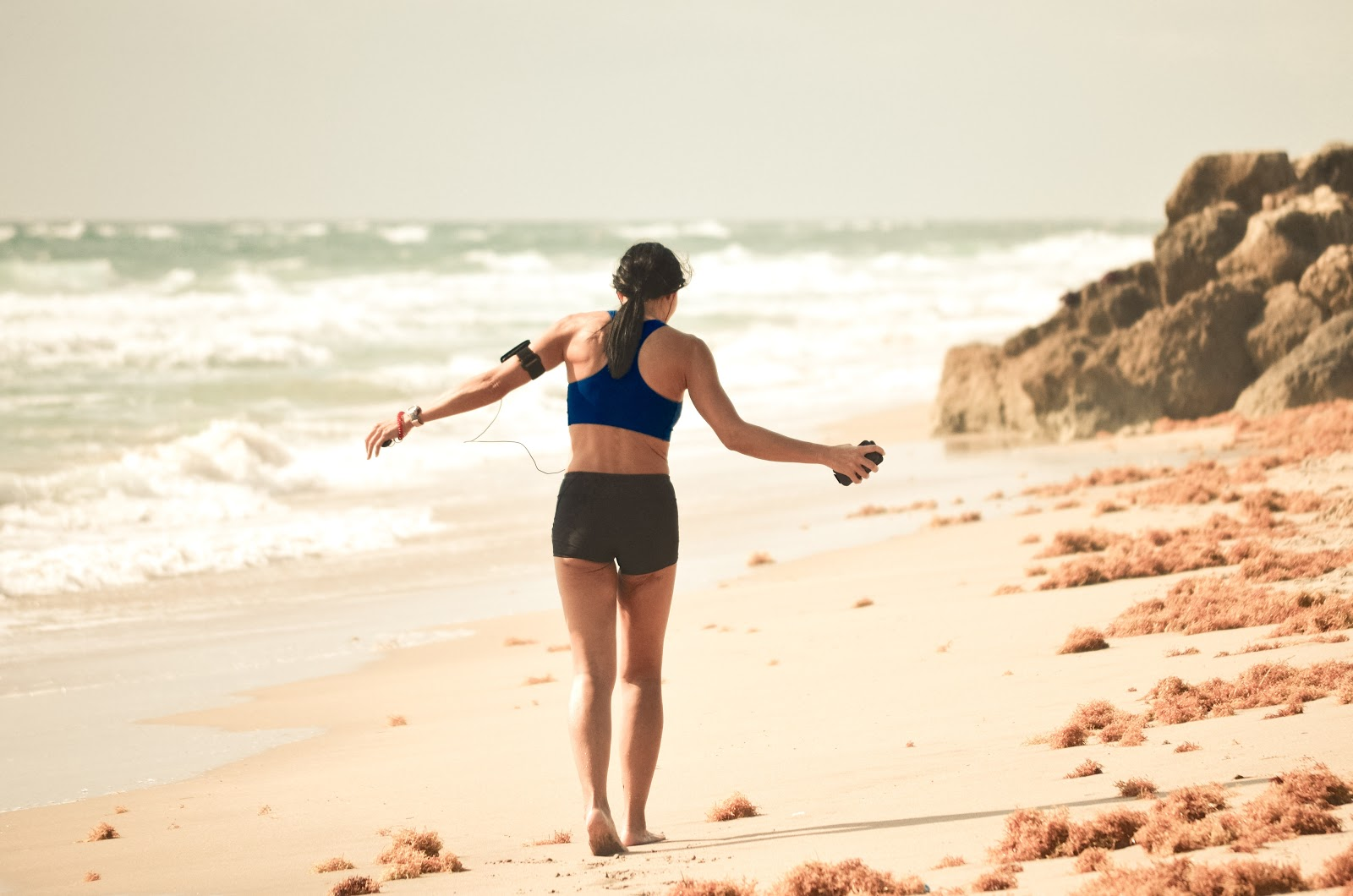 female-working-out-on-beach