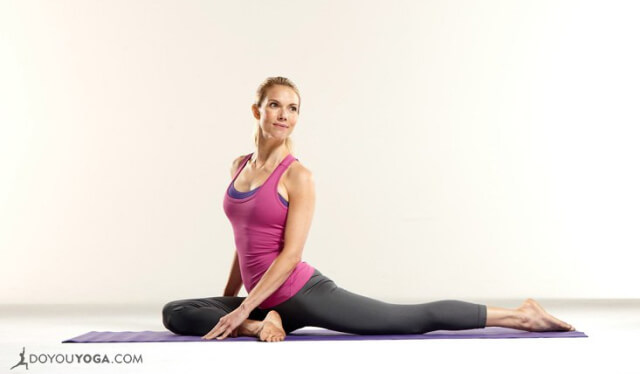 Woman practicing pigeon pose to stretch her piriformis muscles